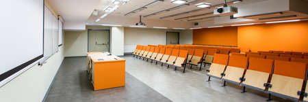 orange chairs: Modern new stylish classroom with orange chairs and marble floor on up-to-date university