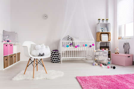 nursery room: Shot of a cosy nursery room for a girl