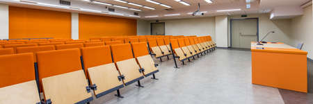 orange chairs: Modern new university and spacious classrooms for seminars. Orange chairs in white room