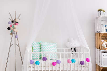 room wall: Shot of a bed in a modern baby room
