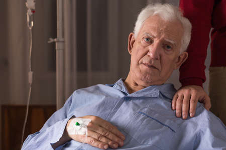 incurable: Image of incurable ill senior man having care Stock Photo
