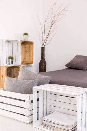 scandinavian: Light room with white walls, large bed and handmade, wood furniture Stock Photo
