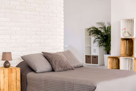 Light Bedroom With White Wall, Large Bed With Grey Bedding And ...