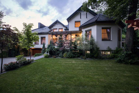 home exterior: Green and neat lawn at front of the house Stock Photo