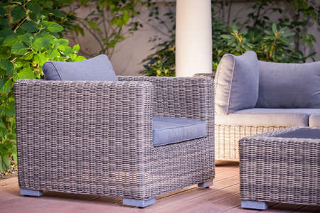 roofed house: Image of comfortable fashionable rattan armchair standing in patio