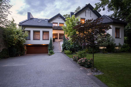 driveways: Frontal view of beautiful stylish villa with garden