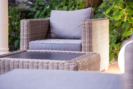 roofed house: Close up of elegant rattan garden furniture