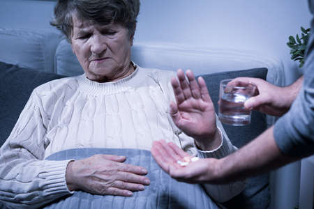Shot of a senior woman refusing to take her medication