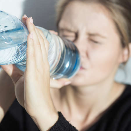 starvation: Image of girl with water during starvation diet