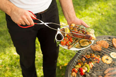 roast meat: Close-up of man serving delicious grilled meal