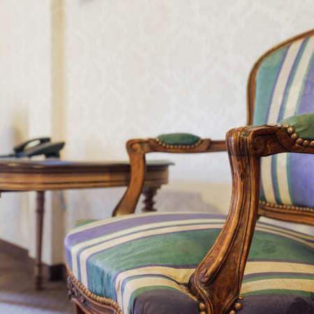colonial: Image of stylish wooden colonial small table and armchairs Stock Photo