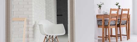 muebles de madera: Elegante comedor blanco con muebles de madera conectados con amplio salón moderno con la silla blanca y espejo grande