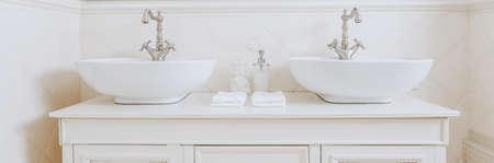 washbasins: Two elegant washbasins in expensive bathroom in white