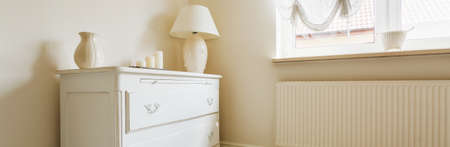 chest of drawers: Delicate and elegant chest of drawers with a lamp on it