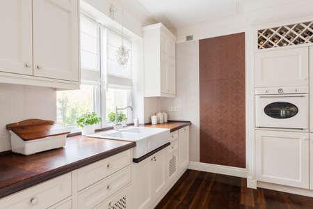 classical style: White elegant sunny kitchen in classic design