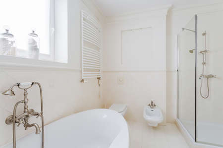 expensive: White sunny bathroom in modern expensive house Stock Photo