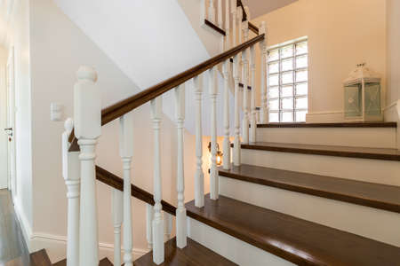 Classic wooden stairs in stylish storey house