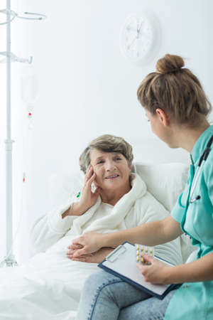 Photo of hospital patient with positive attitude and carer