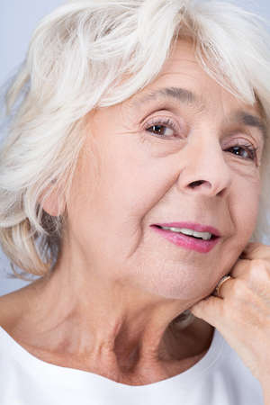 grey haired: Older elegant grey haired woman feeling beautiful and happy after sixties