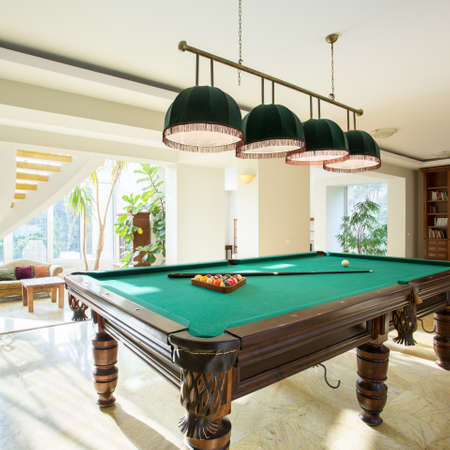 parlour games: Close-up of billiard table in luxury living room