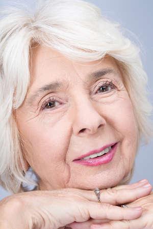 feeling happy: Close-up of elderly happy elegant woman. Feeling proud and confident Stock Photo