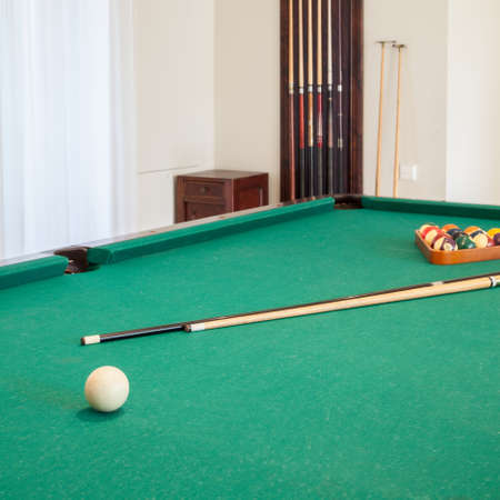 parlour games: Close-up of billiard cue on billiard table
