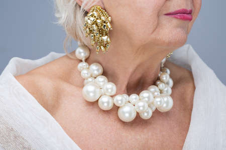 grey haired: Close-up of elderly woman wearing beautiful elegant expensive jewelry