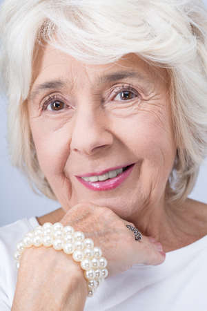aristocracy: Pretty older elegant and proud woman from aristocracy wearing expensive jewelry
