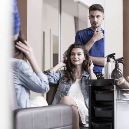 hairdressing: Image of young woman in hairdressing salon Stock Photo