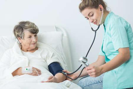 patient care: Image of nurse take care of senior hospital patient
