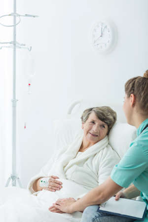 home care: Image of senior rest home resident and carer Stock Photo