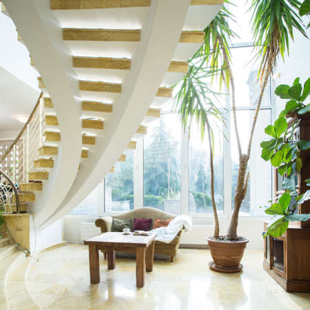 home and garden: Close-up of modern spiral stairs in luxury villa Stock Photo