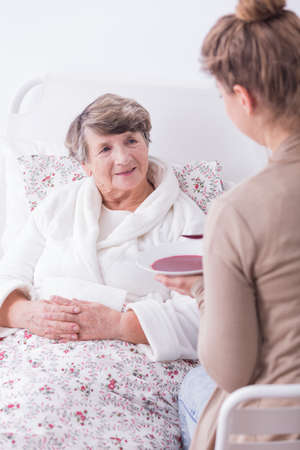 illness: Photo of ill lady having support and care of family Stock Photo