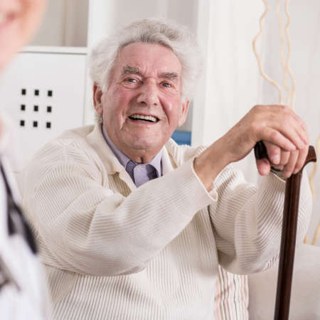dignity: Image of smiling rich old man and his private medic