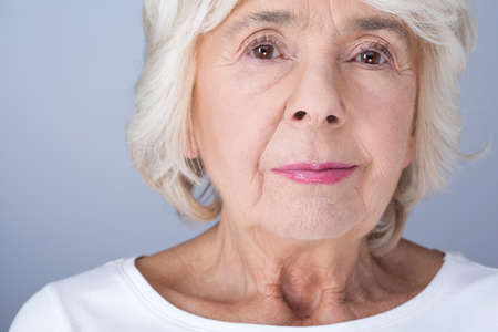 grey haired: Confident senior elegant woman with pretty modest make up