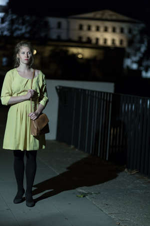 youth crime: Image of lonely girl walking at night