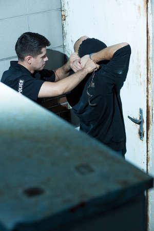 kidnapper: Armed policeman is arresting dangerous masked kidnapper