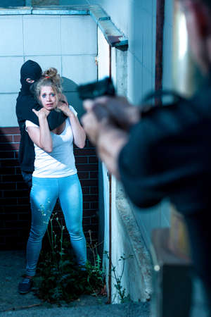 Violence scene of kidnapping young frightened girl Stock Photo