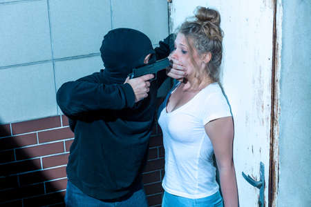 kidnapper: Kidnapper is covering girls mouth with hand Stock Photo