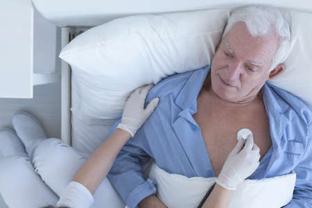 examined: Shot of a patient being examined by a doctor Stock Photo