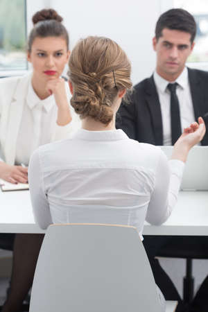 company job: Young female intern on job interview in company