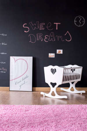 cosy: Shot of a cosy baby room with a blackboard wall Stock Photo