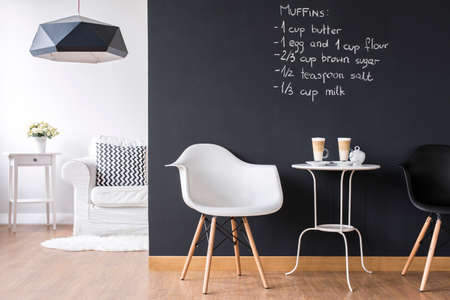Shot of a modern room with a chalkboard wall Stock Photo