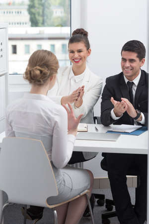 employers: Two employers congratulating the job to young woman