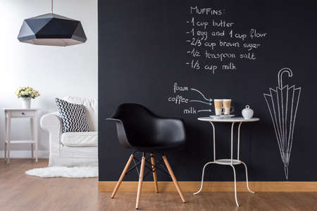 living room wall: Shot of a modern living room with a chalkboard wall