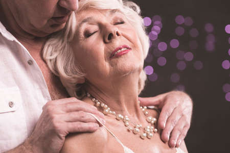 Shot of an elderly man caressing his wife Stock Photo