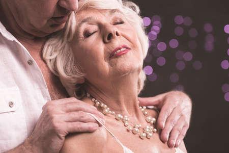 Shot of an elderly man caressing his wife Kho ảnh