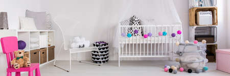 children play area: Shot of a white modern nursery with colorful details Stock Photo