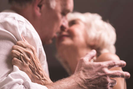 Shot of an elderly couple holding each other