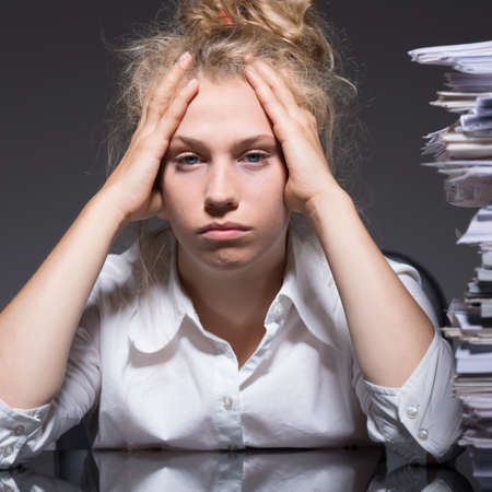 burnout: Picture of female bookkeeper and job burnout